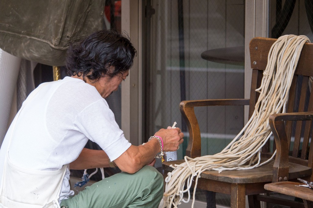 A craftsman working at a small shop in Naka Meguro.
